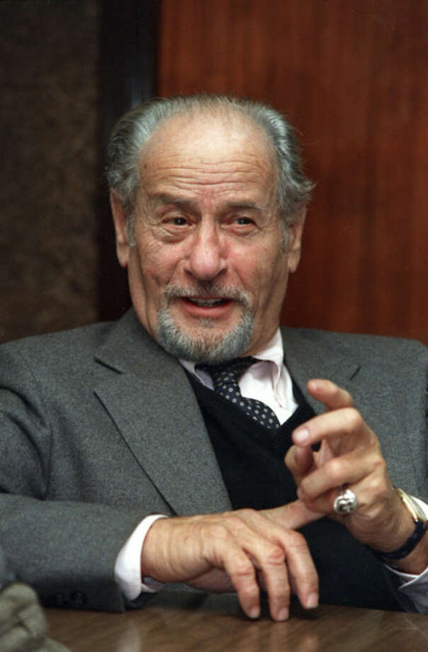 FILE - This Nov. 1987 file photo shows actor Eli Wallach speaking during an interview in New York. Wallach, the raspy-voiced character actor who starred in dozens of movies and Broadway plays over a remarkable and enduring career, died Monday, June 23, 2014 of natural causes. He was 98. (AP Photo/Marty Lederhandler, File)