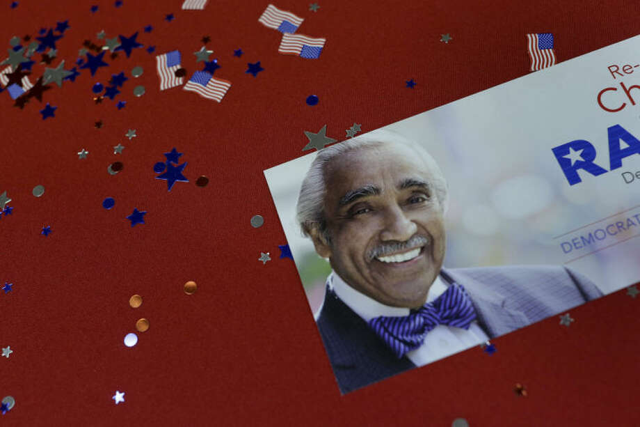 Campaign memorabilia for Rep. Charlie Rangel lays scattered on a table during a primary election night gathering, Wednesday, June 25, 2014, in New York. (AP Photo/Julie Jacobson)
