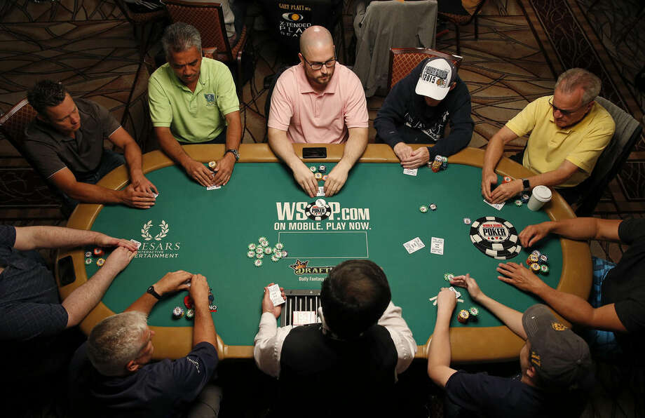 Players compete during the main event at the World Series of Poker Wednesday, July 8, 2015, in Las Vegas. Poker pros and a few celebrities are among 4,371 players who remain in the Las Vegas showdown. (AP Photo/John Locher)