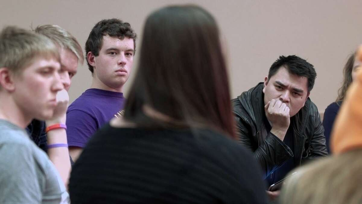 """In this image released by MTV, filmmaker Jose Antonio Vargas, right, listens to a group of young people during the filming of his documentary """"White People."""" The full film debuts Wednesday, July 22, at 8 p.m. ET/PT, offered simultaneously online. (MTV via AP)"""