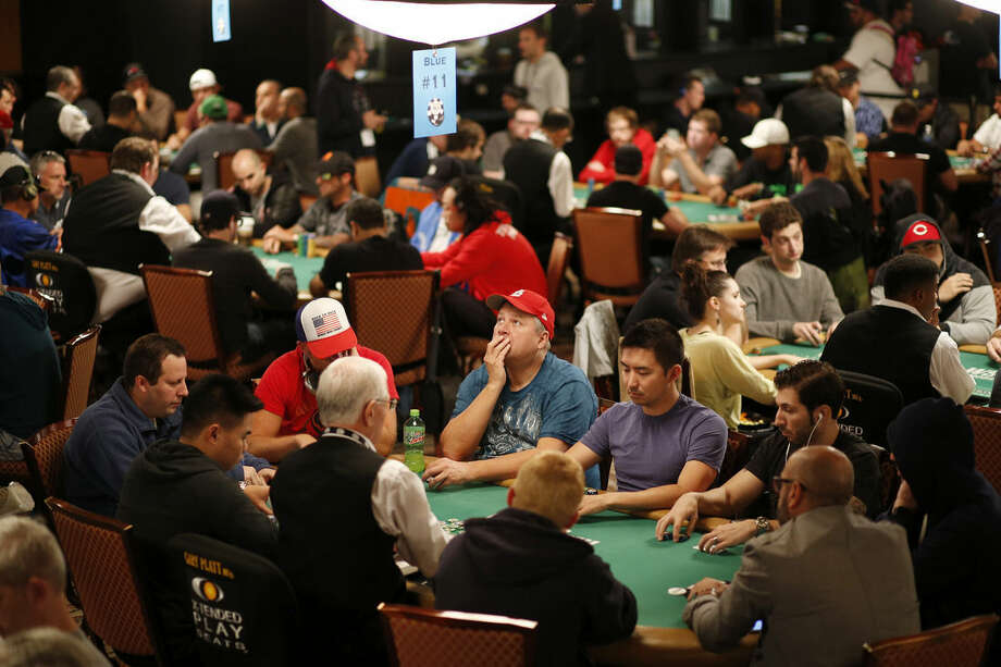 Players compete during the main event at the World Series of Poker Wednesday, July 8, 2015, in Las Vegas. Over 4,000 players remain in the tournament seeking the over $7 million dollar prize.(AP Photo/John Locher)