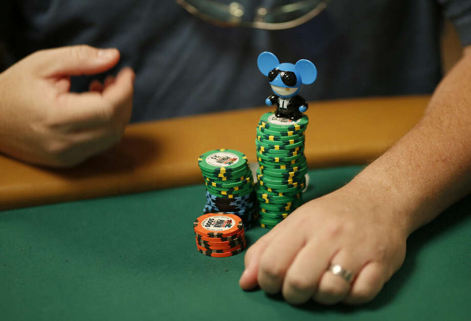 Former main event winner Chris Moneymaker keeps a charm on his stack of chips during the main event at the World Series of Poker Wednesday, July 8, 2015, in Las Vegas. (AP Photo/John Locher)