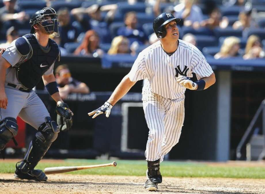 AP photoNew York Yankees' Mark Teixeira watches his eight-inning, tie-breaking, go-ahead, solo home run against the Seattle Mariners on Sunday.
