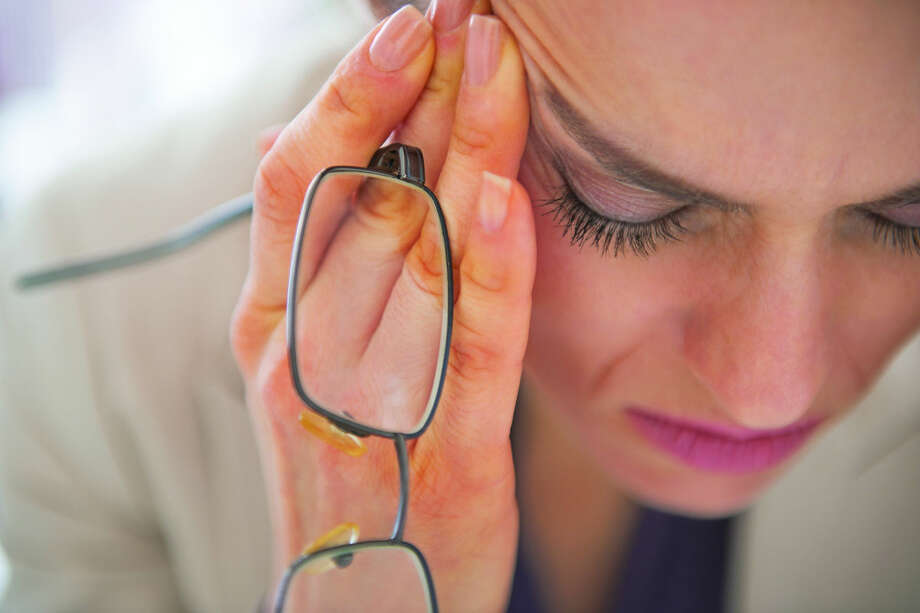 Closeup on stressed business woman with eyeglasses