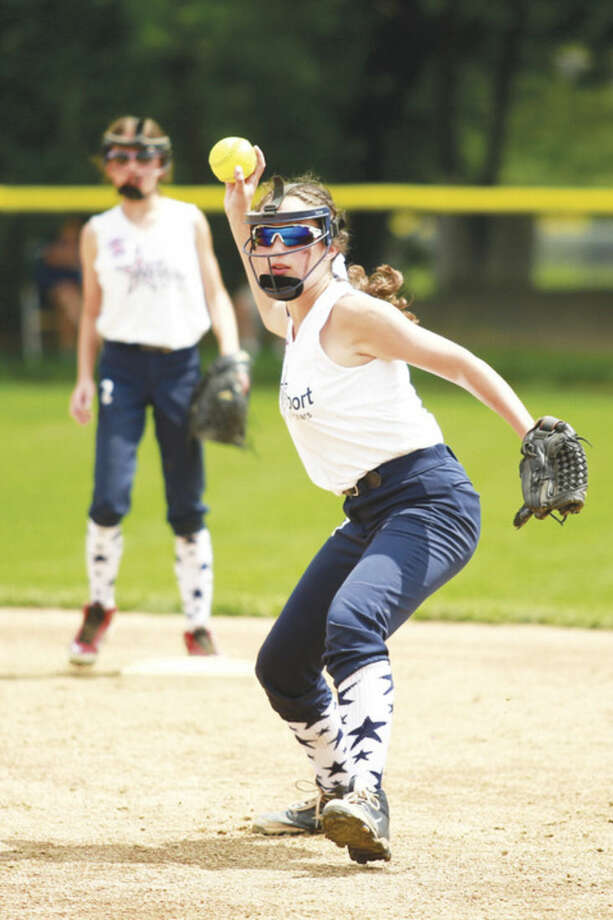 Hour photo/Chris Palermo. Eilie Doran fields a ground ball and throws to first during Westport's loss to Waterford in the Little League softball state championship game in Bristol Sunday.