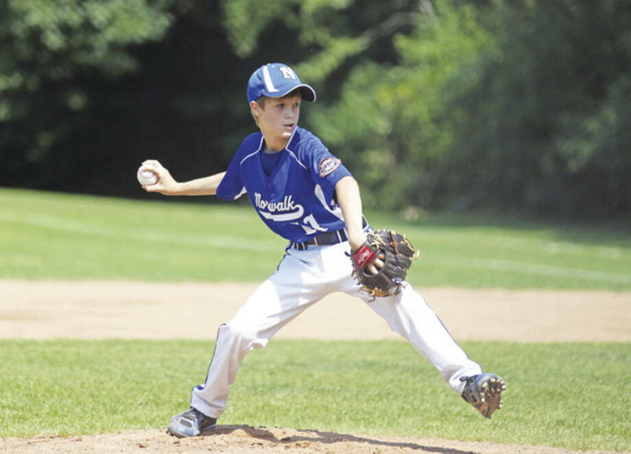 Hour photo/Danielle CallowayNorwalk's Brendan Edvardsen, throws a pitch during the first round of the Cal Ripkin 11-under state tournament against Hebron on Sunday.