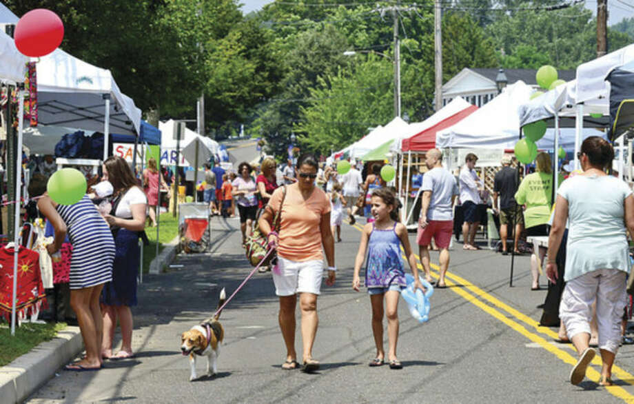 The Wilton Chamber of Commerce held it's second annual Wilton Street Fair & Sidewalk Sale Saturday. The event featured more than 70 vendors selling food and merchandise, including clothes, jewelry and handmade crafts.Hour photo / Erik Trautmann