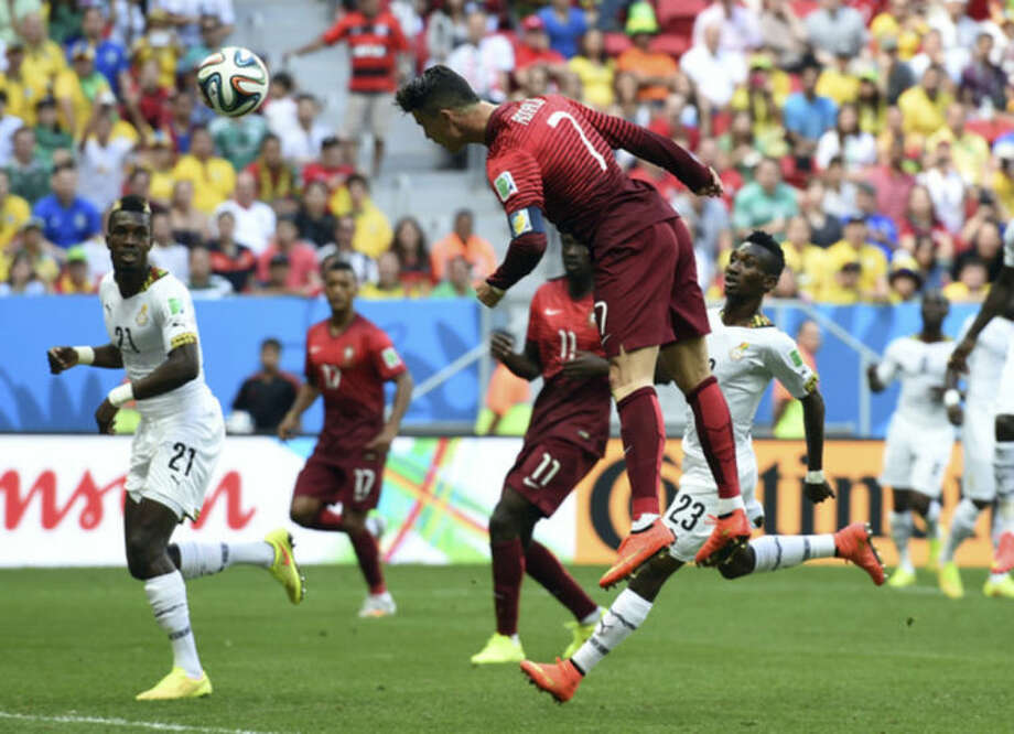 Portugal's Cristiano Ronaldo takes a header on goal during the group G World Cup soccer match between Portugal and Ghana at the Estadio Nacional in Brasilia, Brazil, Thursday, June 26, 2014. (AP Photo/Paulo Duarte)