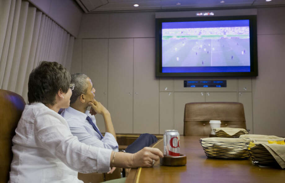 President Barack Obama and White House Senior Adviser Valerie Jarrett watch the World Cup soccer match between US and Germany aboard Air Force One enroute to Minnesota, Thursday, June 26, 2014. (AP Photo/Pablo Martinez Monsivais)