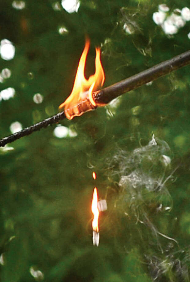 Hour photo / Erik Trautmann Spring Hill Ave was closed at June St Thursday morning after secondary wires caught fire dripping flaming debris into the roadway.