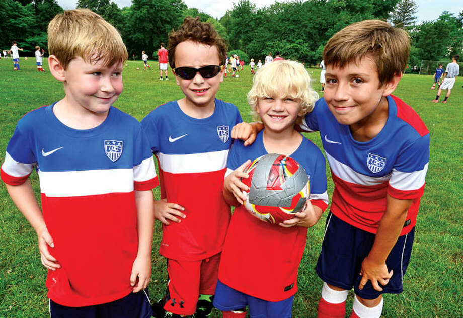 Hour photo / Erik Trautmann Campers at Dick Packer's Soccer Camp including Felix Wiberg, Eli Brody, Gavin Murphy and William Schadt celebrate USA Day Thursday by wearing american flags and official USA jerseys to cheer on USA in World Cup play.