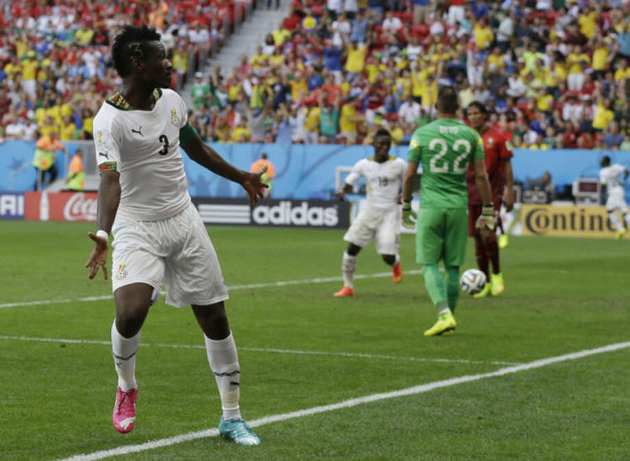 Ghana's Asamoah Gyan celebrates after scoring his side's first goal during the group G World Cup soccer match between Portugal and Ghana at the Estadio Nacional in Brasilia, Brazil, Thursday, June 26, 2014. (AP Photo/Martin Mejia)