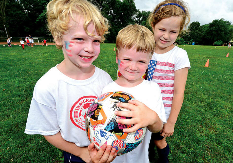 Hour photo / Erik Trautmann Campers at Dick Packer's Soccer Camp including Ridley Phillips, Berkeley Johnson and Mackenzie Majewski celebrate USA Day Thursday by wearing american flags and official USA jerseys to cheer on USA in World Cup play.