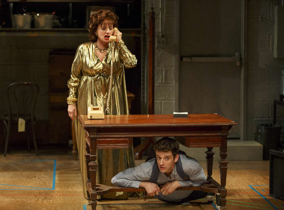 """In this 2015 photo provided by Lincoln Center Theater and Philip Rinaldi Publicity, Patti LuPone, left, and Michael Urie perform in a scene from the play, """"Shows for Days,"""" at the Mitzi E. Newhouse Theater in New York. It's been a month of bad behavior among theatergoers in New York, including a teenager's attempt to charge his phone in a dummy outlet on a stage and an evening when LuPone caught someone texting during her show and swiped the phone out of the patron's hand. (Joan Marcus/Philip Rinaldi Publicity via AP)"""