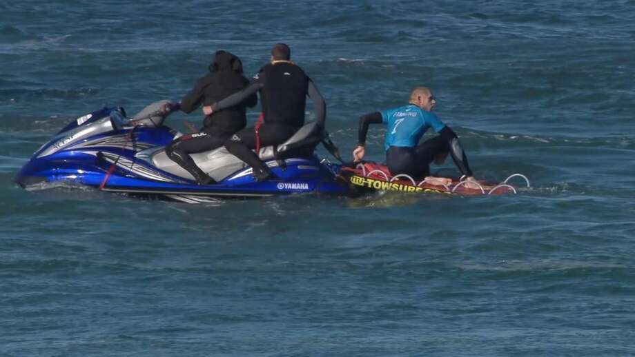 In this screen shot taken from video made available by the World Surf League, Australian surfer Mick Flanning sits on board a rescue boat after being pursued by a shark, in Jeffrey's Bay, South Africa, Sunday, July 19, 2015. Knocked off his board by an attacking shark, a surfer punched the creature during the televised finals of a world surfing competition in South Africa before escaping. Fanning was attacked by a shark on Sunday during the JBay Open but escaped without injuries. (W orld Surf League via AP) MANDATORY CREDIT FOR ALL ONLINE USE PLEASE INCLUDE A LINK TO WORLDSURFLEAGUE.COM.