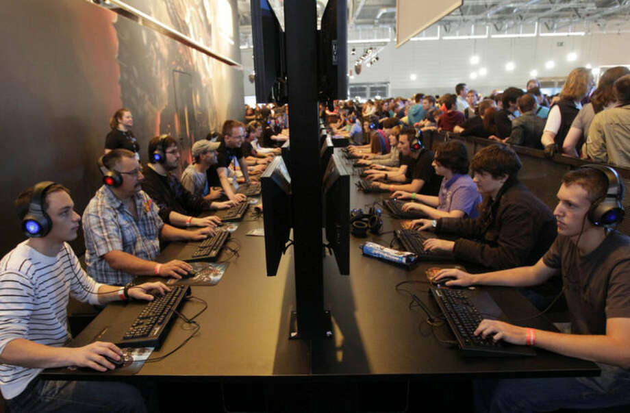 """FILE - In this Aug. 19, 2010 file photo, visitors play games on a computer keyboard during the international gamescom fair in Cologne, western Germany. Frustration over passwords is as common across the age brackets. Bill Lidinsky, director of security and forensics at the School of Applied Technology at the Illinois Institute of Technology, recommends using a """"simple mental algorithm,"""" including those that use a space, if a site allows that. (AP Photo/Frank Augstein, File)"""