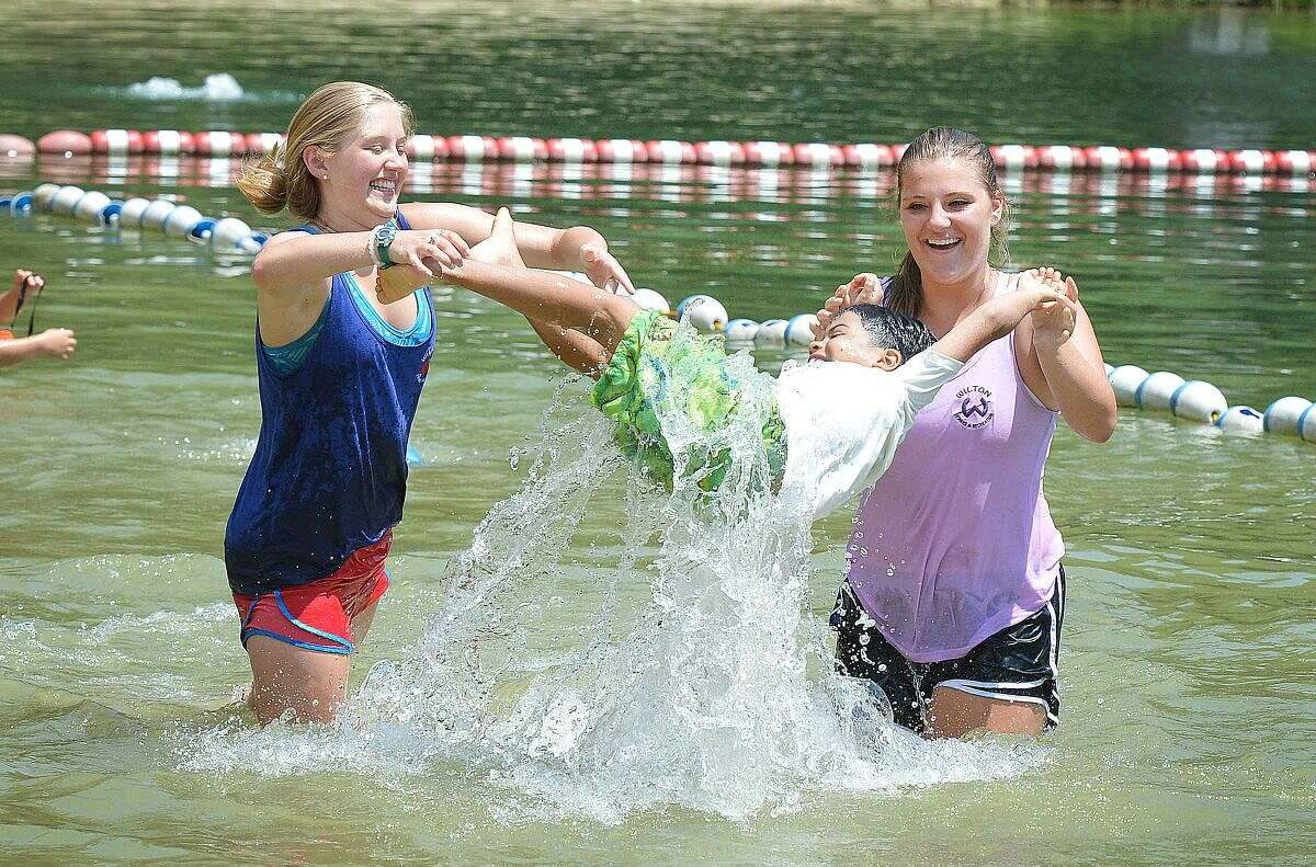 Hour Photo/Alex von Kleydorff Heat and humidity is not a problem for the kids at Wilton's Parks and Recs Summer Camp as counselors Jamie Perry and Caroline Perry keep kids cool in the water at Merwin Meadows Park.