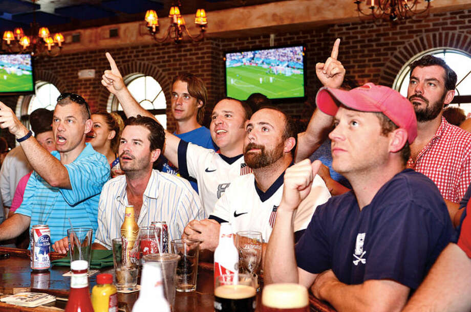 Hour photo / Erik Trautmann David O'Maley, David Gorrie, Teddy Novak, Jason Jeane, Dan Arestia, Patrick Kennedy and Fred Knize cheer for the US in their World Cup match against Germany Thursday afternoon at O'Neill's Pub.
