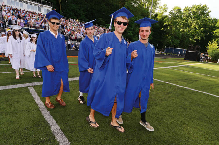 Hour photo / Erik Trautmann Wilton High School seniors including Wesley Wallace and Robert Nastro celebrate their graduation during the Class of 2014 commencement exercises Saturday.
