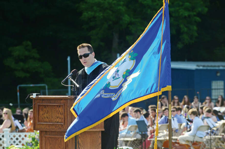 Hour photo / Erik Trautmann Wilton High School executive board president JR Bonhomme announces the class valedictorian during the Class of 2014 commencement exercises Saturday.