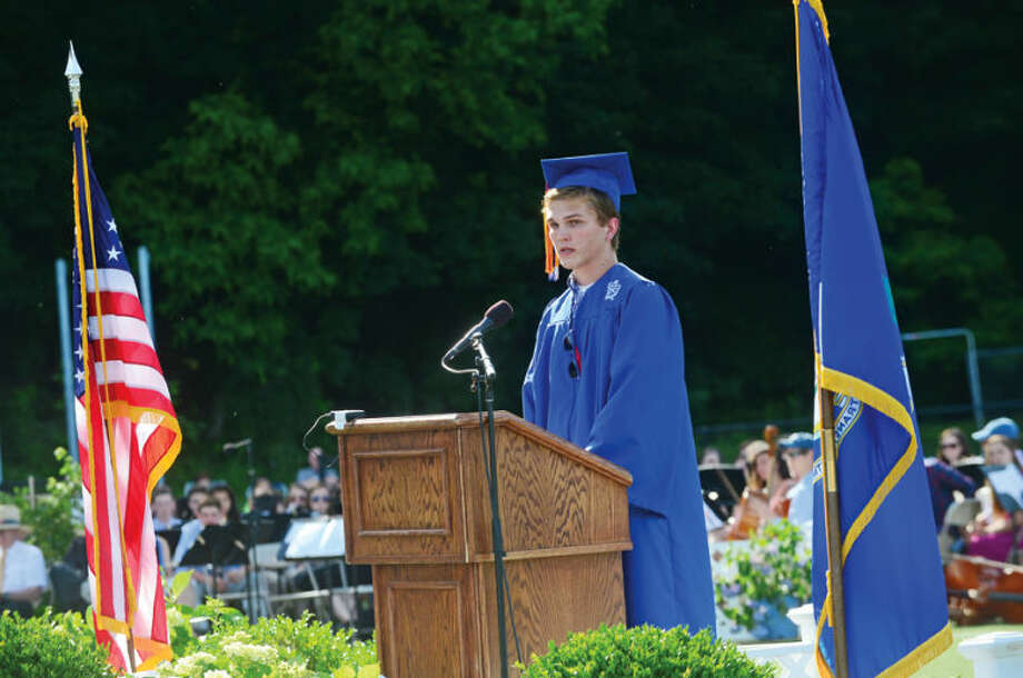 Hour photo / Erik Trautmann Wilton High School senior class president Alex Bendix addresses his class during the Class of 2014 commencement exercises Saturday.