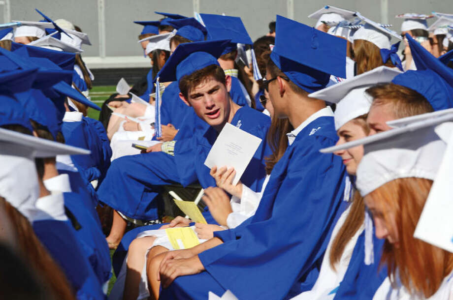 Hour photo / Erik Trautmann Wilton High School seniors celebrate their graduation during the Class of 2014 commencement exercises Saturday.