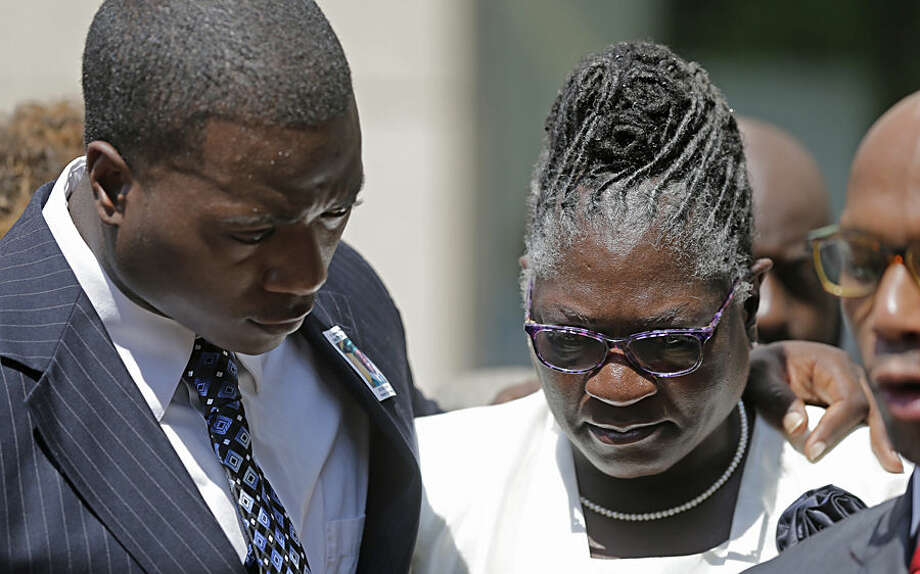 Georgia Ferrell, right, mother of Jonathan Ferrell, is hugged by her son William Ferrell, left, during a news conference on the first day of the trial of former Charlotte-Mecklenburg police Officer Randall Kerrick, in Charlotte, N.C., Monday, July 20, 2015. Investigators say Kerrick shot Jonathan Ferrell, who was unarmed, 10 times during an investigation of a possible home invasion. (AP Photo/Chuck Burton)