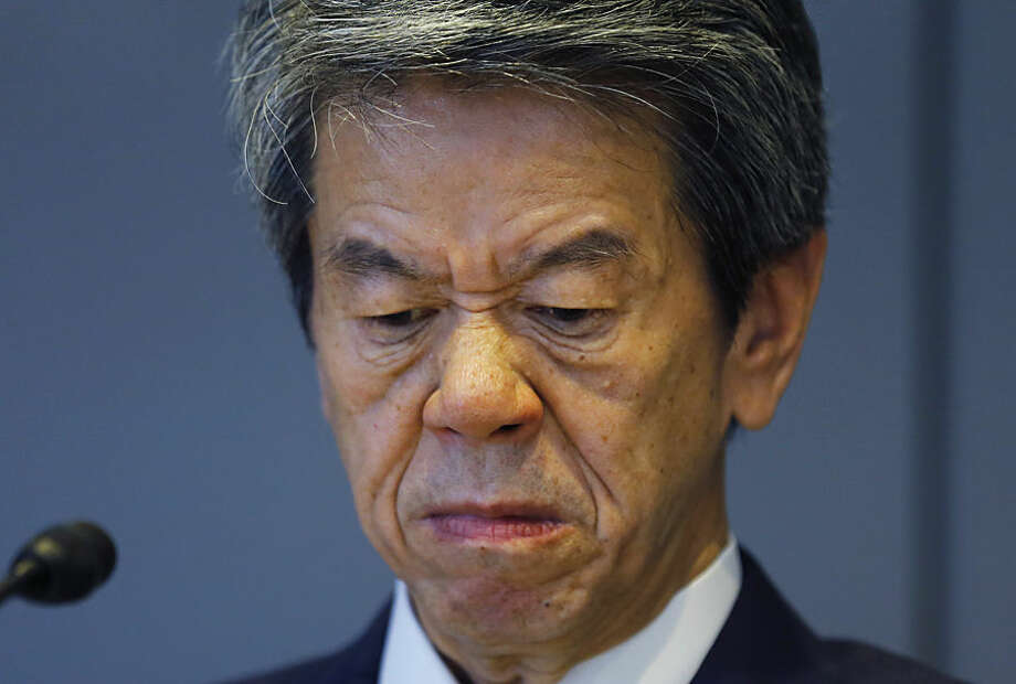 "Toshiba Corp. CEO Hisao Tanaka grimaces during a press conference to announce his resignation at the company's headquarters in Tokyo, Tuesday, July 21, 2015. Tanaka stepped down Tuesday to take responsibility for doctored books that inflated profits at the Japanese technology manufacturer by 151.8 billion yen ($1.2 billion). Toshiba acknowledged a systematic cover-up, which began in 2008, as various parts of its sprawling business including computer chips and personal computers were struggling financially, but top managers set unrealistic earnings targets under the banner of ""challenge."" (AP Photo/Shizuo Kambayashi)"