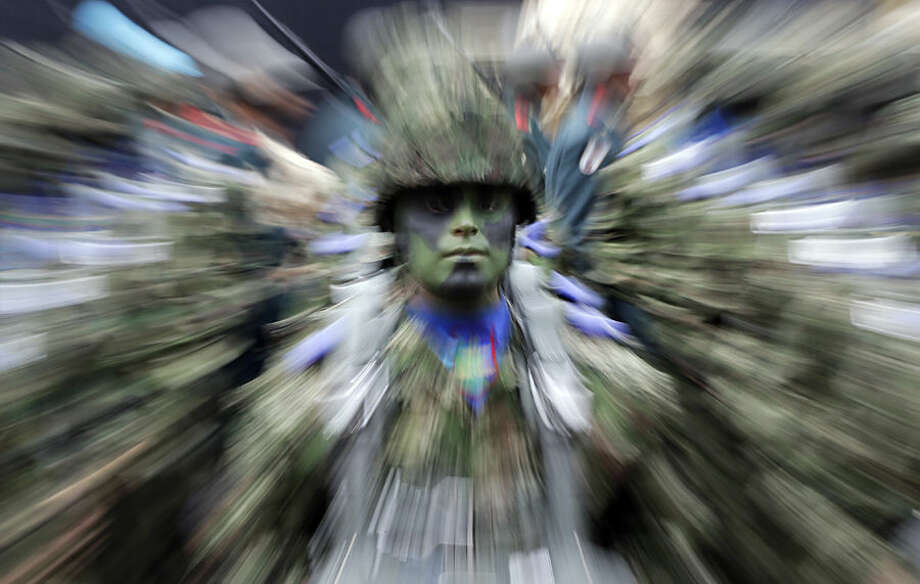 A Colombian soldier stands in formation during a military parade celebrating his country's 205th anniversary of independence from Spain, in Bogota, Colombia, Monday, July 20, 2015. (AP Photo/Fernando Vergara)