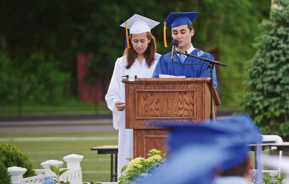 Hour photo / Erik Trautmann Senior class co-presidentLarkin Brown and vice-president Anthony Saltarelli presnt the class gift to Wilton High School during the Class of 2014 commencement exercises Saturday.