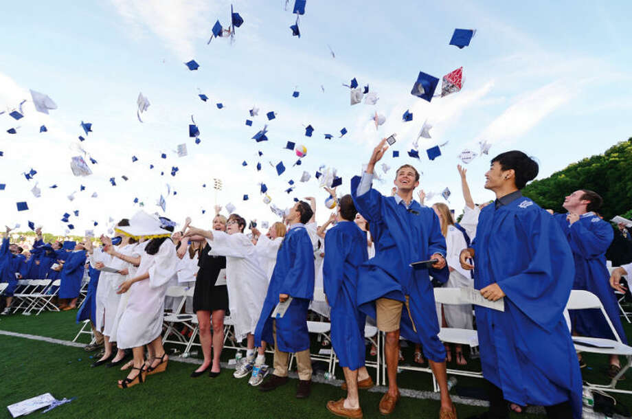 Hour photo / Erik Trautmann Wilton High School seniors celebrate their graduation during the Class of 2014 commencement exercises Saturday.