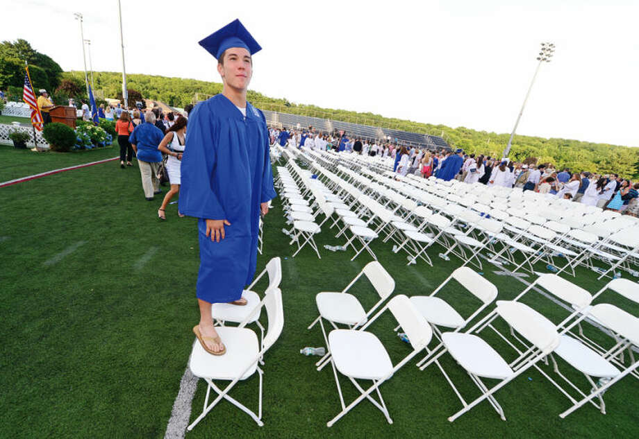 Hour photo / Erik Trautmann Wilton High School graduate Andew Sakamoto looks for relatives following the Class of 2014 commencement exercises Saturday.