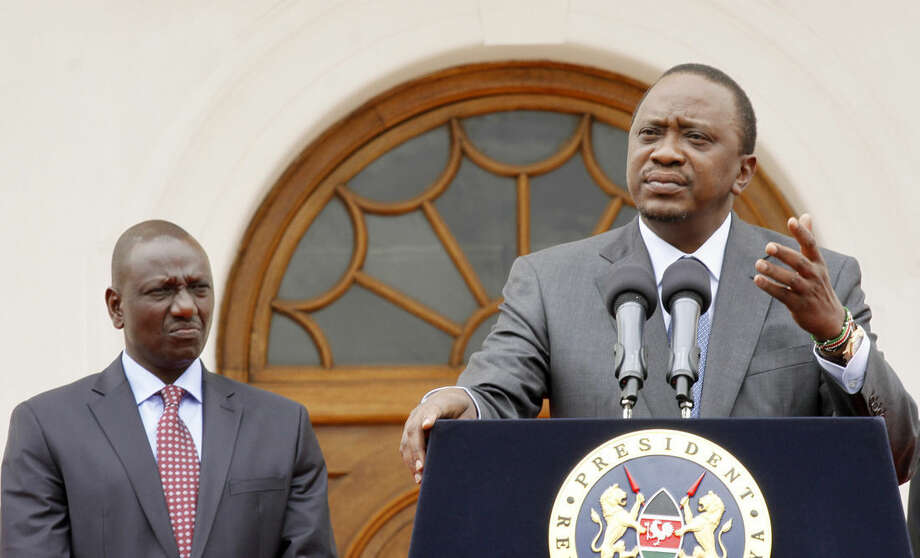 Kenya's President Uhuru Kenyatta, right, accompanied by Deputy President William Ruto, left, speaks to the media about the upcoming visit of President Barack Obama, amongst other issues, at State House in Nairobi, Kenya Tuesday, July 21, 2015. President Barack Obama is due to make his first trip as president to Kenya later this week, the country of his father's birth, to attend the Global Entrepreneurship Summit, which brings together business leaders, international organizations and governments. (AP Photo/Khalil Senosi)