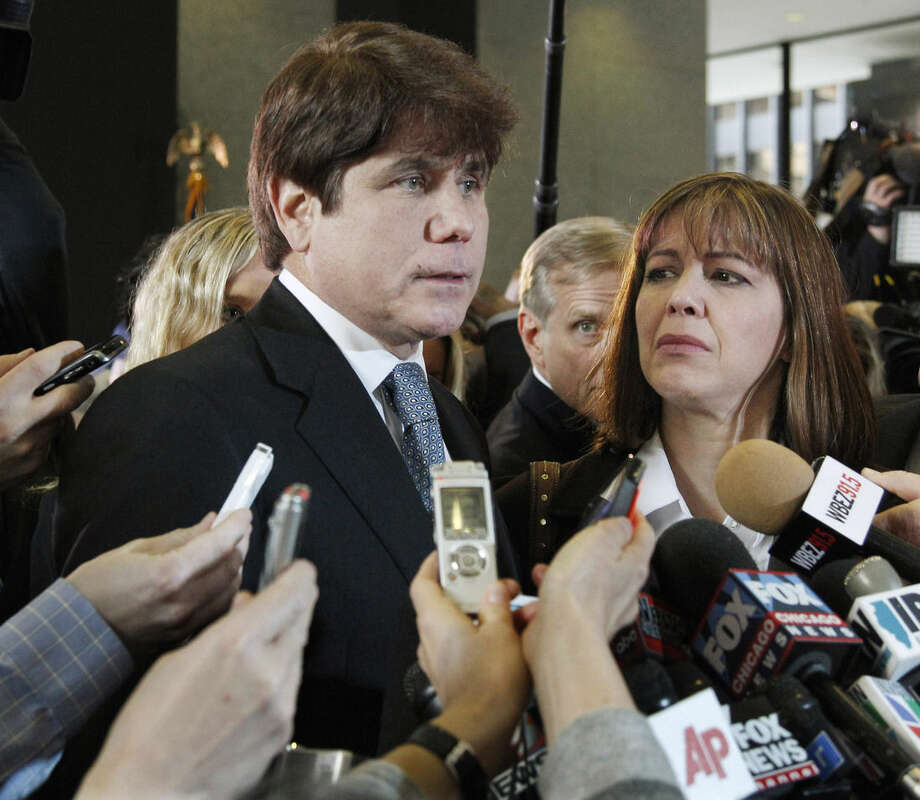FILE - In this Dec. 7, 2011 file photo, former Illinois Gov. Rod Blagojevich, left, speaks to reporters as his wife, Patti, listens at the federal building in Chicago, after Blagojevich was sentenced to 14 years on 18 corruption counts. In a ruling released Tuesday, July 21, 2015, the 7th U.S. Circuit Court of Appeals overturned some of the corruption convictions of the imprisoned former governor, saying prosecutors did not prove Blagojevich broke the law as he appeared to try to auction off an appointment to President Barack Obama's old Senate seat. (AP Photo/M. Spencer Green, File)