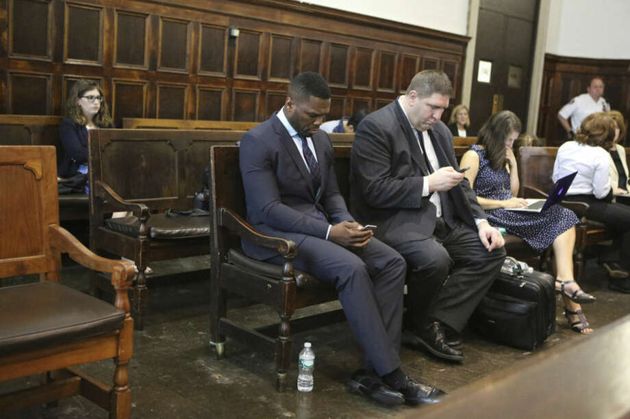 Curtis Jackson, aka 50 Cent, center, waits to testify in a lawsuit about a sex tape he allegedly posted online in Manhattan Supreme Court on Tuesday, July 21, 2015 in New York. (Jefferson Siegel/New York Daily News/POOL)