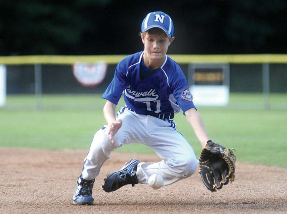 Cal Ripken Norwalk player Brendan Edvardsen with an infield play against New Milford. Hour photo/Matthew Vinci