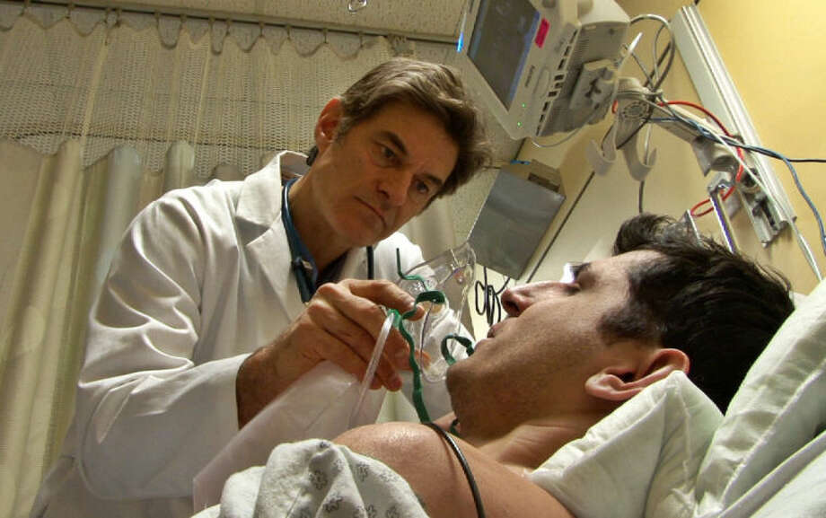 """In this image provided by ABC, Dr. Mehmet Oz works with a patient in a scene from the new season of """"NY Med,"""" premiering, Thursday, June 26, 2014, at 10 p.m. EDT. (AP Photo/ABC, Donna Svennevik)"""