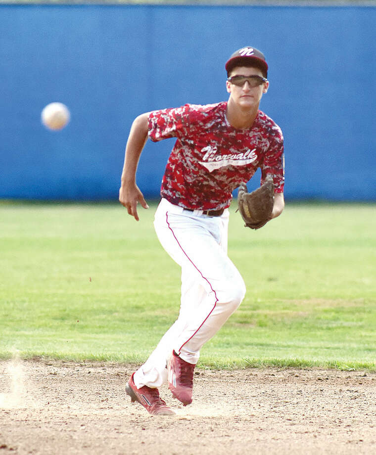 Hour photo/John Nash - Norwalk Post 12 Junior Legion second baseman Jake Fishman watches a bounding ball find its way through the infield, one of 14 hits Meriden pounded out in four-plus innings of Tuesday's 11-1 win.