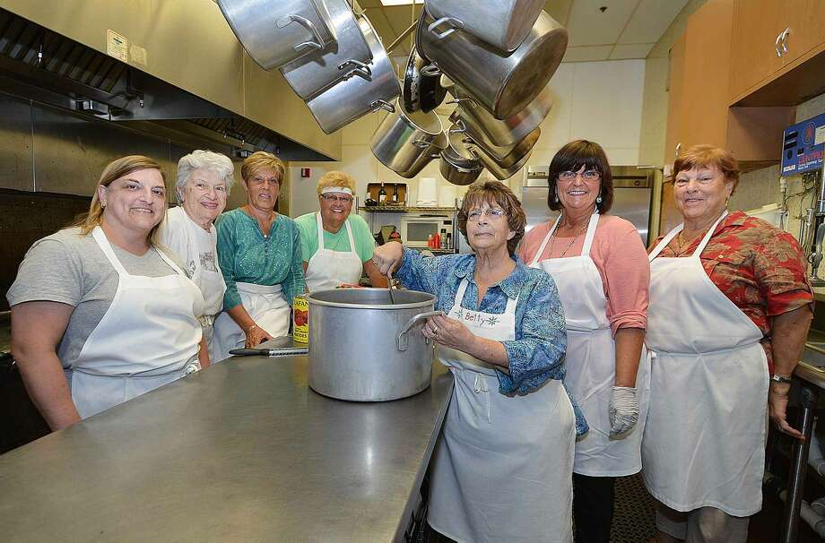 Hour Photo/Alex von Kleydorff The hard working women of the kitchen crew , Maria Vozzo, Frankie Marucci, Joanne Guaglione, Camile Andreozzi, Betty Tavella Brink, Christine Francello and Mary Ann Cappuccia keep the italian food coming for the St Ann feast this weekend