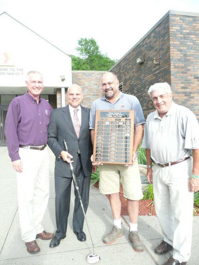 Pictured left to right are: Y Executive Director Bob McDowell, Event Sponsor Frank Rowella of Reynolds and Rowella,Golf Committee Chair Nick Lee, and Y Board President Howard Steinberg.