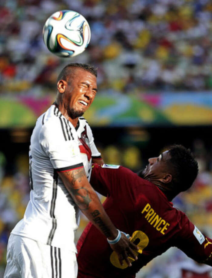 Ghana's Kevin-Prince Boateng, right, challenges Germany's Jerome Boateng during the group G World Cup soccer match at the Arena Castelao in Fortaleza, Brazil, Saturday, June 21, 2014. (AP Photo/Matthias Schrader)
