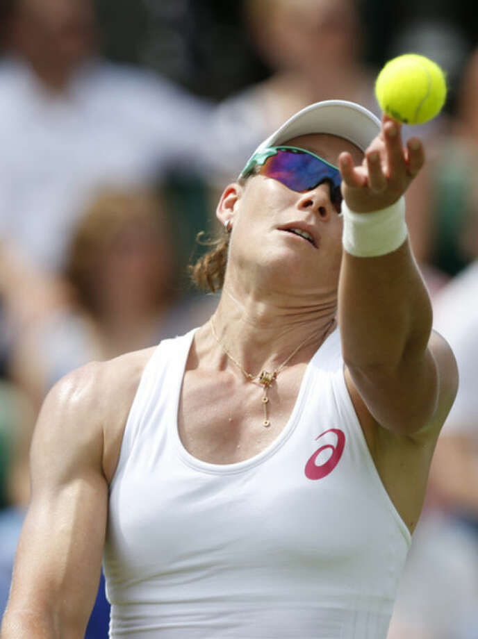 Australia's Samantha Stosur serves to Belgium's Yanina Wickmayer during their first round match at the All England Lawn Tennis Championships in Wimbledon, London, Monday, June 23, 2014. (AP Photo/Sang Tan)
