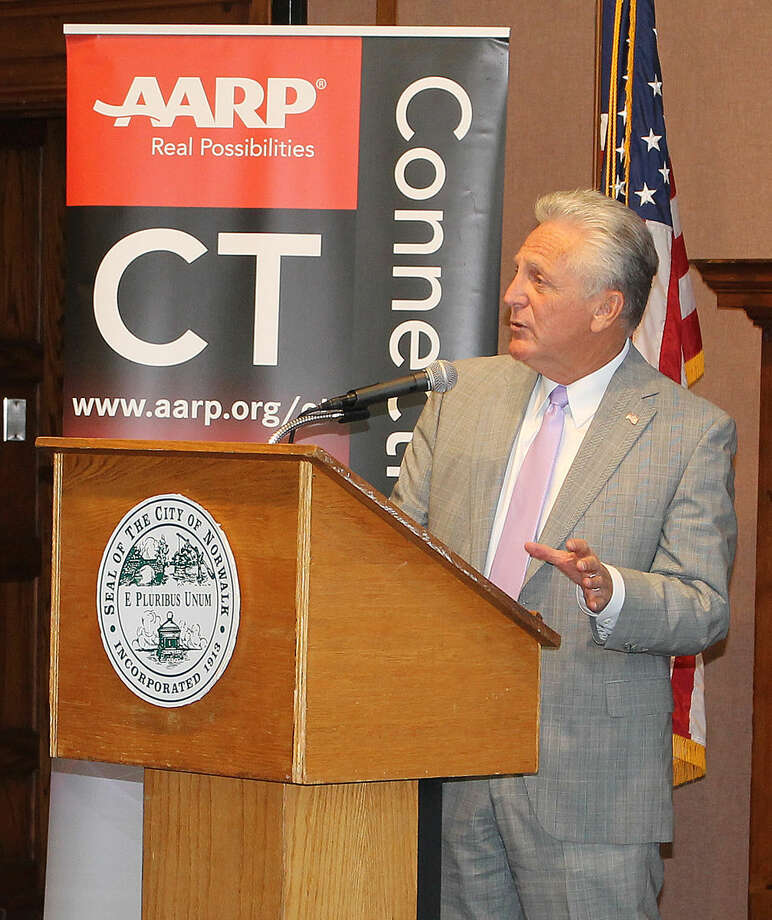 Hour Photo/ Rachel Sawyer Norwalk Mayor Harry Rilling speaks at the AARP and SBA event on Wednesday at City Hall.