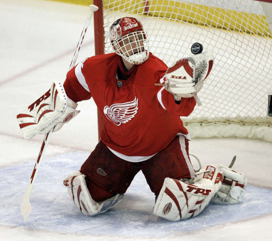 FILE - In this April 3, 2008 file photo, Detroit Red Wings goalie Dominik Hasek, of the Czech Republic, stops a Columbus Blue Jackets' Rick Nash shot in the first period of an NHL hockey game in Detroit. Hasek is expected to be part of the class of 2014 at the Hockey Hall of Fame, which will be announced Monday, June 23, 2014. (AP Photo/Paul Sancya, File)