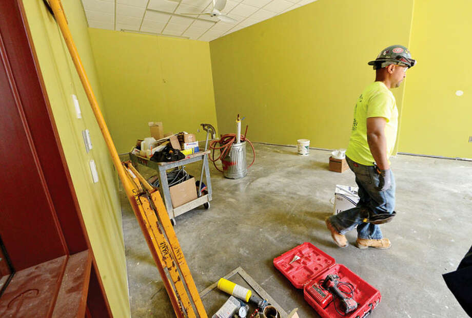 Hour photo / Erik Trautmann Work continues in the spinning room at the new Westport Weston Familty Y 54,000-square-feet facility in Westport set to open this fall.