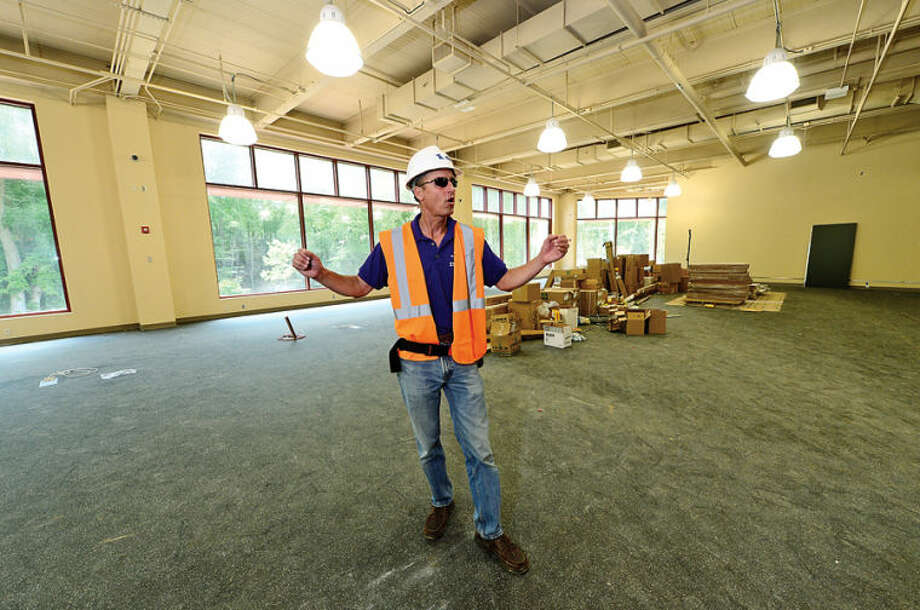 Hour photo / Erik Trautmann Westport Weston YMCA Communications Director Scott Smith leads a tour of the new Westport Weston Familty Y 54,000-square-feet facility including the Robin Tauck Wellness Center set to open this fall.