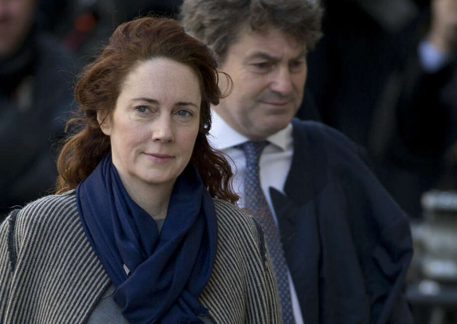 FILE - This is a Friday, Feb. 21, 2014 file photo of Rebekah Brooks former News International chief executive and her husband Charlie Brooks, arrive at the Central Criminal Court in London where they appear to face charges related to phone hacking. Former News of the World editor Andy Coulson has been convicted of phone hacking, on Tuesday June 24, 2014 but fellow editor Rebekah Brooks was acquitted after a months long trial centering on illegal activity at the heart of Rupert Murdoch's newspaper empire. (AP Photo/Alastair Grant)