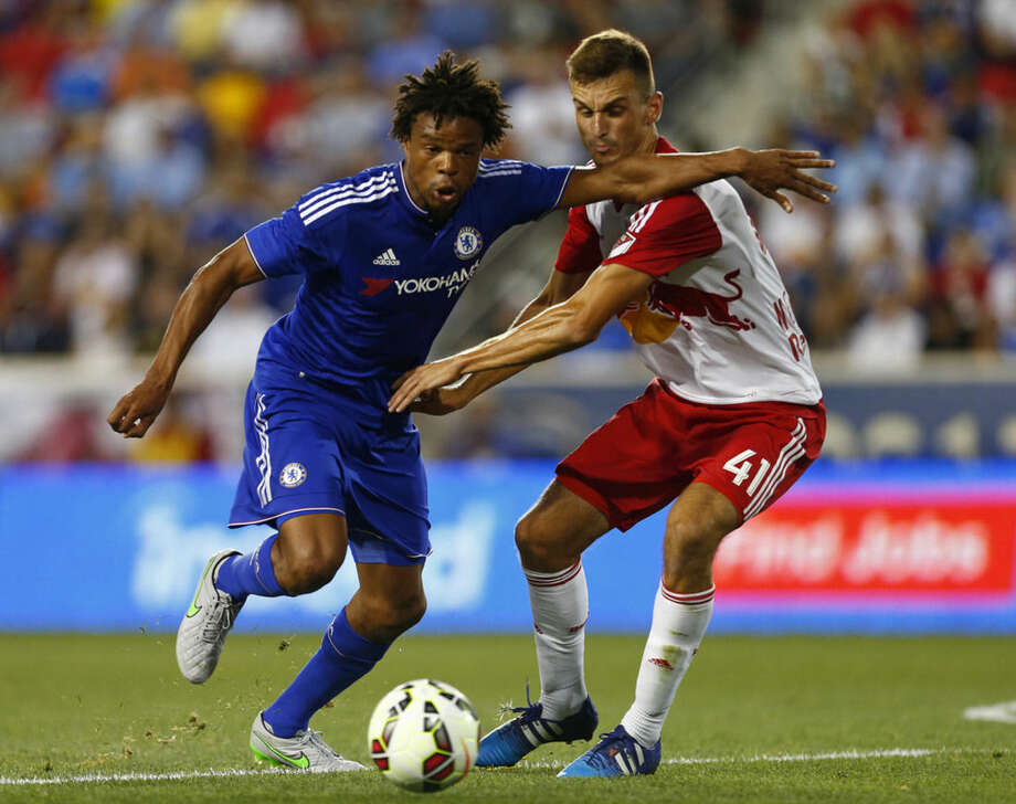 Chelsea FC forward Loic Remy, left, is checked by New York Red Bulls midfielder Konrad Plewa (41) in the first half during a soccer match in the International Champions Cup in Harrison N.J., Wednesday, July 22, 2015. (AP Photo/Rich Schultz)