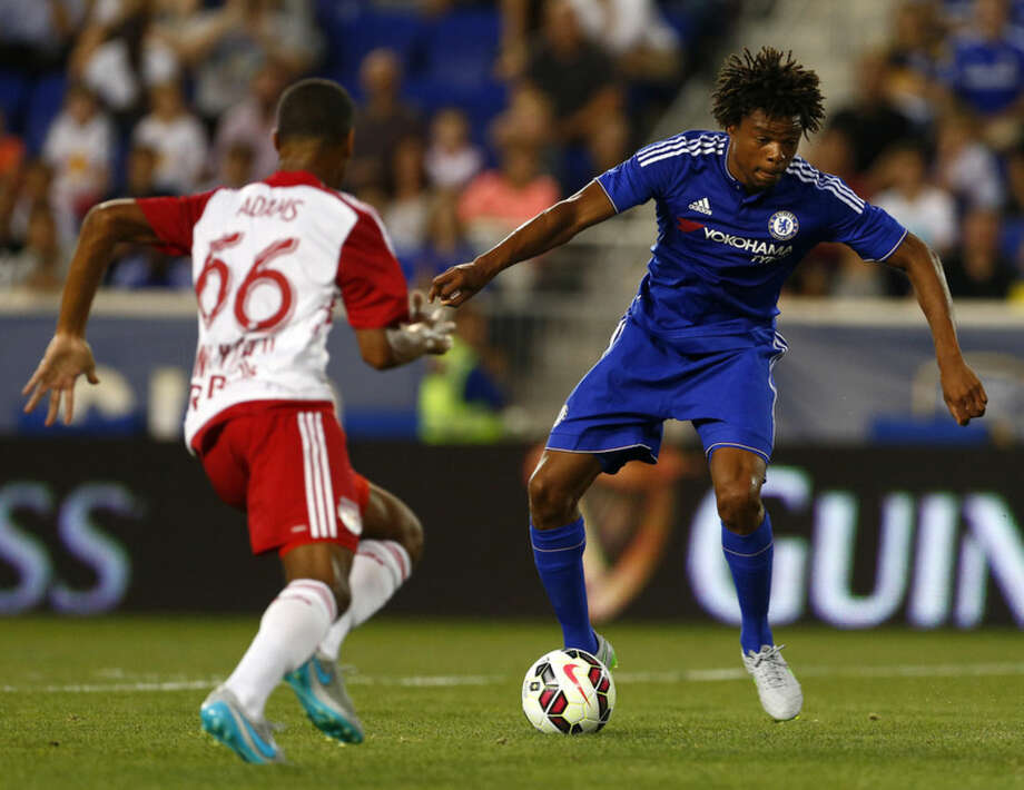 Chelsea FC forward Loic Remy, right, is checked by New York Red Bulls defender Tyler Adams (66) as he sets up his goal-scoring shot in the first half during a soccer match in the International Champions Cup in Harrison N.J., Wednesday, July 22, 2015. (AP Photo/Rich Schultz)