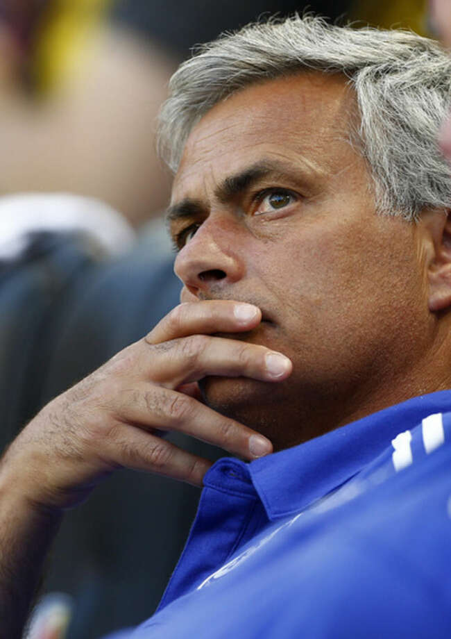 Chelsea FC manager Jose Mourinho looks on from the bench during warmups before a soccer match against the New York Red Bulls in the International Champions Cup in Harrison, N.J., Wednesday, July 22, 2015. (AP Photo/Rich Schultz)